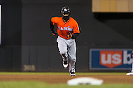 Giancarlo Stanton #27 of the Miami Marlins runs toward 3rd base against the Minnesota Twins in Game 2 of a split doubleheader on April 23, 2013 at Target Field in Minneapolis, Minnesota.  The Marlins defeated the Twins 8 to 5.  Photo: Ben Krause