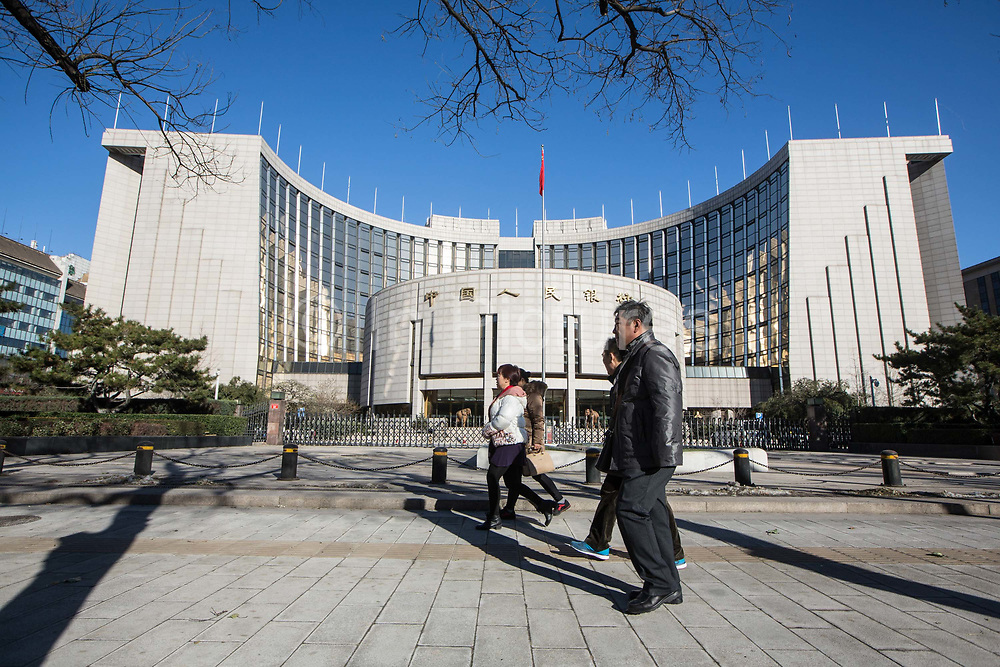 Pedestrians walks by the Peoples Bank of China PBOC in Beijing, China, on Tuesday, Dec. 01, 2015.