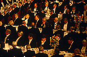 Listening intently to a speech given by the Rt. Hon. Kenneth Clarke MP, the then-Chancellor in John Major's Conservative government of 1994, these city and financial dignitaries have feasted well in the old Guildhall, the City of London's town hall - the Guildhall - in the historic financial district of the capital. Wearing formal banquet attire, these chiefs of industry appear to be an all-male audience though there were also women sat at tables during the Banker's Dinner held every in June when the Chancellor of the Exchequer delivers a speech known as the Mansion House Speech hosted by the Lord Mayor, which takes its name from his official residence nearby. They concentrate on the speech to hear the Chancellor's predictions for growth and prosperity.