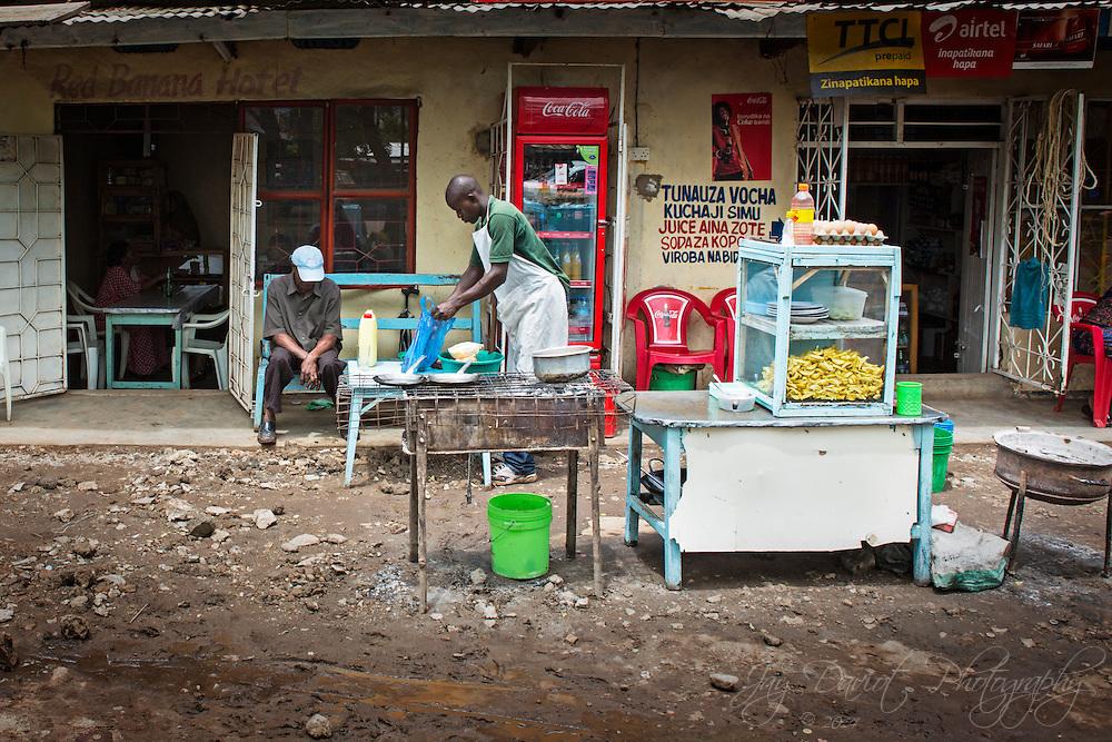 A street vendor makes chips in Mto Wa Mbu, Tanzania.