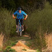 Adam Grice rides his bike at the Dirtlab Mountain Bike Skills Park at Haw Ridge Park in Oak Ridge, Tennessee. Nathan Lambrecht/Journal Communications