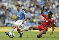 Photo: Aidan Ellis.<br /> Manchester City v Portsmouth. The Barclays Premiership.<br /> 27/08/2005.<br /> Manchester's Claudio Reyna is challenged by Pompy's John Viafara