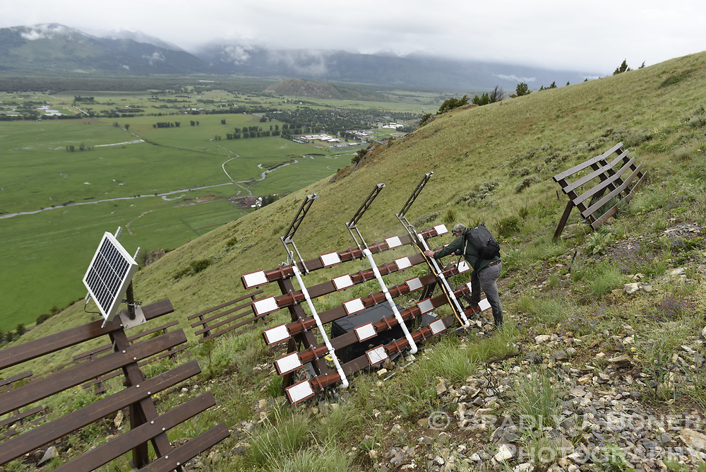 Wyoming Department of Transportation avalanche technician John Fitzgerald evaluates snow fences above mile marker 151 on S. Highway 28