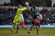 Rowan Liburd of Wycombe Wanderers has a header blocked by Goalkeeper Jamie Jones of Stevenage .Skybet football league two match, Wycombe Wanderers  v Stevenage Town at Adams Park  in High Wycombe, Buckinghamshire on Saturday 12th March 2016.<br /> pic by John Patrick Fletcher, Andrew Orchard sports photography.