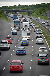 Slow moving traffic heading Southbound on the M5 Motorway in Somerset. The bank holiday getaway was brought to a standstill for many motorists as soaring temperatures led to an increase in breakdowns.