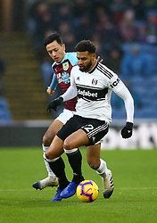 Burnley's Dwight McNeil (left) and Fulham's Cyrus Christie battle for the ball during the Premier League match at Turf Moor, Burnley.
