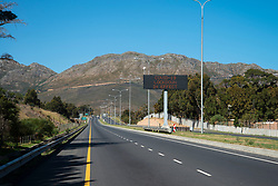 """A digital display reads: """"COVID-19 lockdown in effect,"""" on the N2 from Strand toward Sir Lowry's Pass and Grabouw, in the Western Cape, South Africa, on Saturday, April 18, 2020. The South African government has shut down the country, in response to Coronavirus, asking everyone but essential workers to stay home. PHOTO: EVA-LOTTA JANSSON<br /> [This is one is a series of landscapes shot in the Western Cape, South Africa, during the national ockdown in response to the Coronavirus.]"""