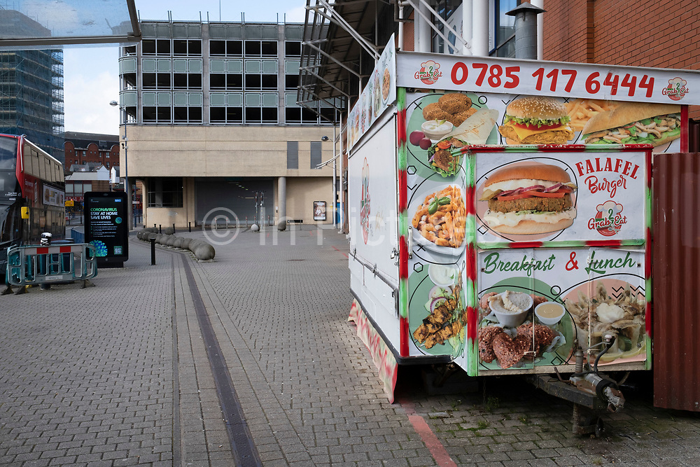 Closed up burger van in Birmingham city centre is virtually deserted due to the Coronavirus outbreak on 31st March 2020 in Birmingham, England, United Kingdom. Following government advice most people are staying at home leaving the streets quiet, empty and eerie. Coronavirus or Covid-19 is a new respiratory illness that has not previously been seen in humans. While much or Europe has been placed into lockdown, the UK government has announced more stringent rules as part of their long term strategy, and in particular social distancing.