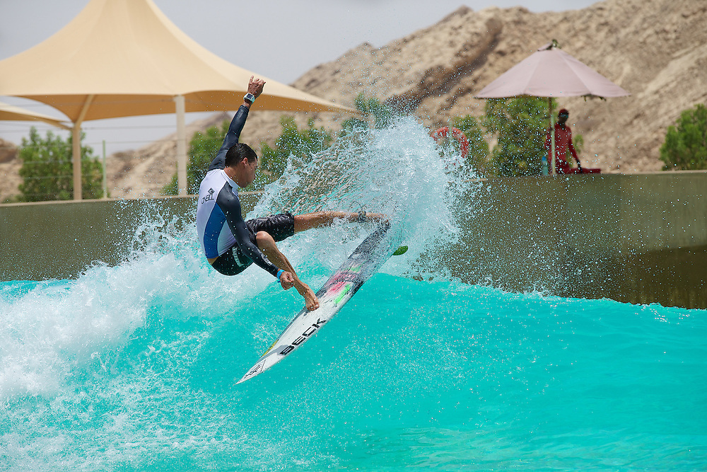 Graeme Fenton busting air and showing his Gas Fins in the desert at Wadi Adventure, Al Ain, United Arab Emirates