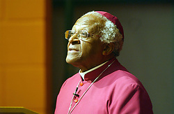 The most Revd Desmond Tutu FKC, Archbishop of Emeritus and Visiting Professor in Post-Conflict Societies, King's College London speaking during a meeting with Professor Jonathan Sacks FKC, Chief Rabbi and Visiting Professor in the Department of Theology and Religious Studies, King's College London, and  The Most Revd Dr Rowan Williams, Archbishop of Canterbury and The College Visitor, King's College London, The Revd Dr Richard Burridge FKC, Dean of King's College London, chaired the three-way conversation between Tutu, Sacks and Williams at The Greenwood Theatre, King's College London, Guy's campus.