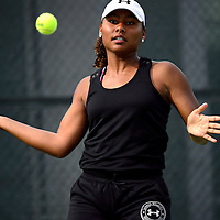 050913  Adron Gardner/Independent<br /> <br /> Grants Pirate Paris Corley Albuquerque volleys to Academy Charger Melissa Pick during the 4A Tennis State Championship championship match at the Jerry Cline Tennis Center in Albuquerque Thursday.