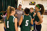 Stephen Greenwood gives his Holy Trinity team a pep talk before taking to the court against the Laconia Police Dept during their community game on Saturday morning.  (Karen Bobotas/for the Laconia Daily Sun)