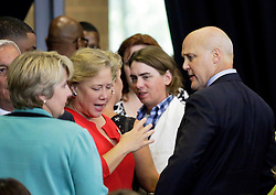 27 August 2015. Andrew P. Sanchez & Copelin-Byrd Multi Service Center, Lower 9th Ward, New Orleans, Louisiana.<br /> Mayor Mitch Landrieu and his sister Mary (in red - former Senator for Louisiana) before President Barack Obama speaks. <br /> Photo credit©; Charlie Varley/varleypix.com.
