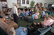 """Aug 10, 2008 -- COLORADO CITY: Members of the Jessop family have a prayer service in the living room of their home in Colorado City, AZ. The Jessops are polygamists and members of the FLDS. Colorado City and neighboring town of Hildale, UT, are home to the Fundamentalist Church of Jesus Christ of Latter Day Saints (FLDS) which split from the mainstream Church of Jesus Christ of Latter Day Saints (Mormons) after the Mormons banned plural marriage (polygamy) in 1890 so that Utah could gain statehood into the United States. The FLDS Prophet (leader), Warren Jeffs, has been convicted in Utah of """"rape as an accomplice"""" for arranging the marriage of teenage girl to her cousin and is currently on trial for similar, those less serious, charges in Arizona. After Texas child protection authorities raided the Yearning for Zion Ranch, (the FLDS compound in Eldorado, TX) many members of the FLDS community in Colorado City/Hildale fear either Arizona or Utah authorities could raid their homes in the same way. Older members of the community still remember the Short Creek Raid of 1953 when Arizona authorities using National Guard troops, raided the community, arresting the men and placing women and children in """"protective"""" custody. After two years in foster care, the women and children returned to their homes. After the raid, the FLDS Church eliminated any connection to the """"Short Creek raid"""" by renaming their town Colorado City in Arizona and Hildale in Utah.     Photo by Jack Kurtz / ZUMA Press"""