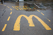 Drive through McDonalds on The Highway on 24th February 2020 in London, United Kingdom. A drive-through or drive-thru is a type of take-out service provided by a business that allows customers to purchase products without leaving their cars. The format was pioneered in the US and which has since spread to other countries.