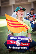 """June 13 - PHOENIX, AZ: BAO NGUYEN, from Garden Grove, CA, and an immigrant from Vietnam, at an immigrants' rally and vigil in Phoenix Sunday. About 40 immigrants' rights activists from Anaheim, California, joined Phoenix area activists at the Arizona State Capitol Sunday for a prayer vigil and rally against SB 1070, the Arizona law that gives local law enforcement agencies the power to ask to see proof of immigration status in the course of a """"lawful contact"""" and when """"practicable."""" Immigrants' rights and civil rights activist say the bill will lead to racial profile. Proponents of the bill say it is the toughest local anti-immigration bill in the country and merely brings state law into line with federal immigration law.  The law, which was signed by the Arizona Governor in April, goes into effect on July 29, 2010.   Photo by Jack Kurtz"""
