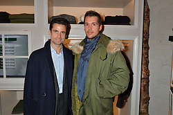 Left to right, LEO FENWICK and ADAM KELLY at the launch of the Private White VC flagship store, 73 Duke Street, London on 11th December 2014.