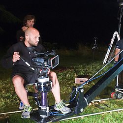The camera man works with his crew to practice the shots before  filming.