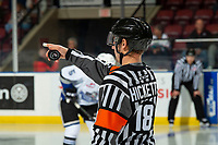 KELOWNA, BC - NOVEMBER 20:  Referee Matt Hicketts stands with the puck at the face-off between the Kelowna Rockets and Victoria Royals at Prospera Place on November 20, 2019 in Kelowna, Canada. (Photo by Marissa Baecker/Shoot the Breeze)