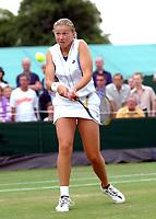 Michaela Krajicek (Holland) half sister of former Wimbledon Champion Richard, playing in the Girls Doubles final. Wimbledon Tennis Championship, Day 13, 6/07/2003. Credit: Colorsport / Matthew Impey DIGITAL FILE ONLY