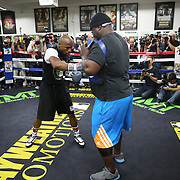 LAS VEGAS, NV - APRIL 14: WBC/WBA welterweight champion Floyd Mayweather Jr. (L) works out with co-trainer Nate Jones at the Mayweather Boxing Club on April 14, 2015 in Las Vegas, Nevada. Mayweather will face WBO welterweight champion Manny Pacquiao in a unification bout on May 2, 2015 in Las Vegas.  (Photo by Alex Menendez/Getty Images) *** Local Caption *** Floyd Mayweather Jr., Nate Jones