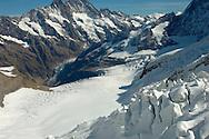 Mountains; mountain; Jungfrau; Bernese; Oberland; Alps; Switzerland; summit; top; peak; snow; snowy; drifts; deep; glacier; landscape; ice; cold; freeze; frost; freezing; natural; nature; tourist; travel; hostile; inhositibable; high; altitude; 13000; feet climbers; climb; dangerous; clean; refreshing; exhilerating; Top; Of; Europe; Jungfraujoch; Alpine ; Swiss ;