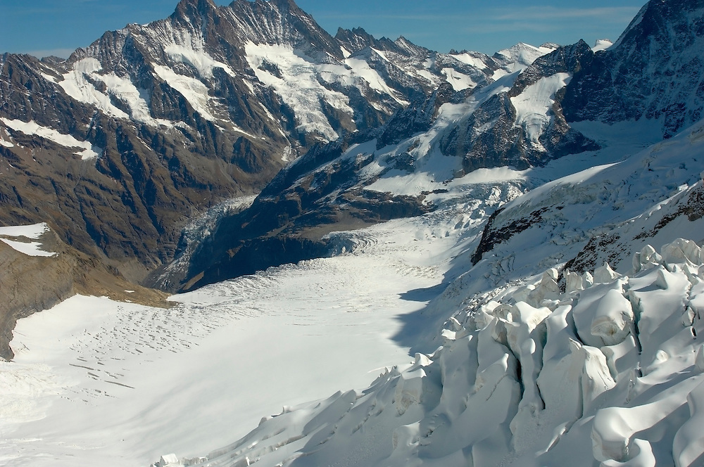 Mountains; mountain; Jungfrau; Bernese; Oberland; Alps; Switzerland; summit; top; peak; snow; snowy; drifts; deep; glacier; landscape; ice; cold; freeze; frost; freezing; natural; nature; tourist; travel; hostile; inhositibable; high; altitude; 13000; feet climbers; climb; dangerous; clean; refreshing; exhilerating; Top; Of; Europe; Jungfraujoch; Alpine ; Swiss ; .<br /> <br /> Visit our SWITZERLAND  & ALPS PHOTO COLLECTIONS for more  photos  to browse of  download or buy as prints https://funkystock.photoshelter.com/gallery-collection/Pictures-Images-of-Switzerland-Photos-of-Swiss-Alps-Landmark-Sites/C0000DPgRJMSrQ3U