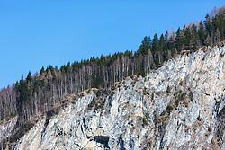 "THEMENBILD - ein Teil der schroffen Felswand ""Falkenbachwand"" mit Nadelbäumen und blauem Himmel, aufgenommen am 07. April 2018, Kaprun, Österreich // Part of the rugged rock face ""Falkenbachwand"" with coniferous trees and blue sky on 2018/04/07, Kaprun, Austria. EXPA Pictures © 2018, PhotoCredit: EXPA/ Stefanie Oberhauser"
