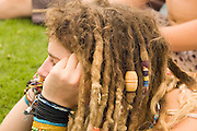 Young blond female teen with dreadlocks