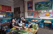 A portrait of China's most famous leader, Chairman Mao Zedong decorates a small restaurant in the town of Longyan in southern Fujian Province.