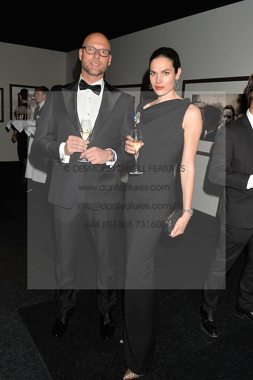 ANNA DRIJVER and EDWIN DE VRIES at the IWC Schaffhausen Gala Dinner in honour of the British Film Institute held at the Battersea Evolution, Battersea Park, London on 7th October 2014.