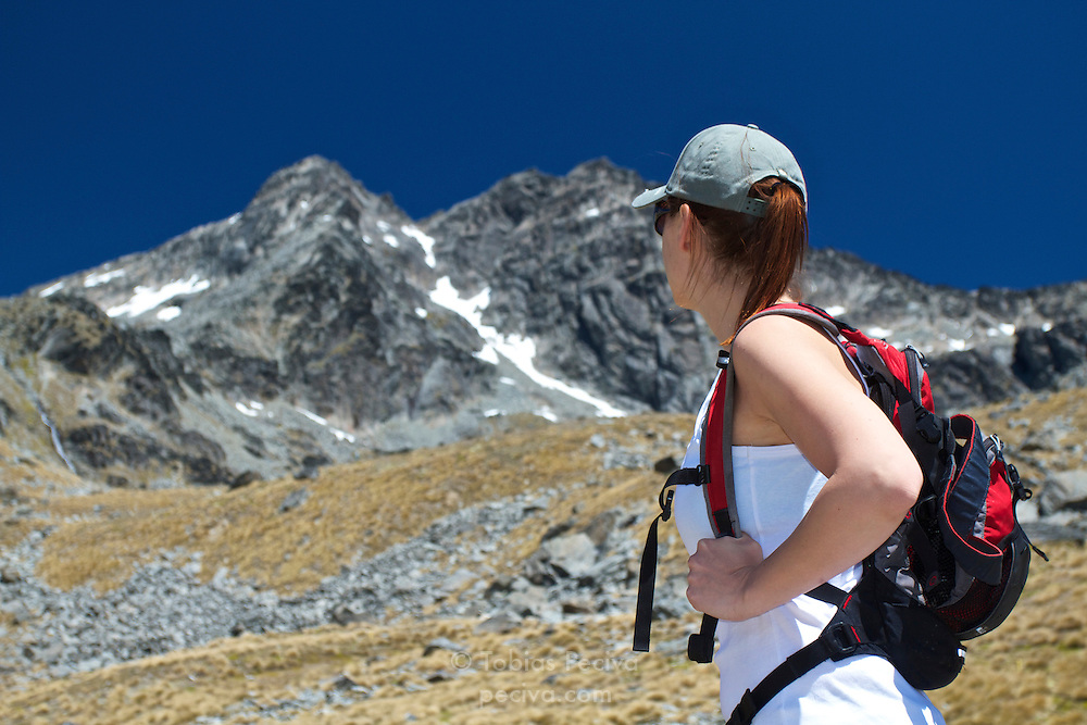Hiker enjoys the view of Double Cone in The Remarkables, near Queenstown.