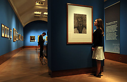 An employee of the Royal Collection Trust looks at Lucian Freud's Self-Portrait:Reflection, which is on display in the Portrait of the Artist exhibition at the Queen's Gallery, Buckingham Palace, London.