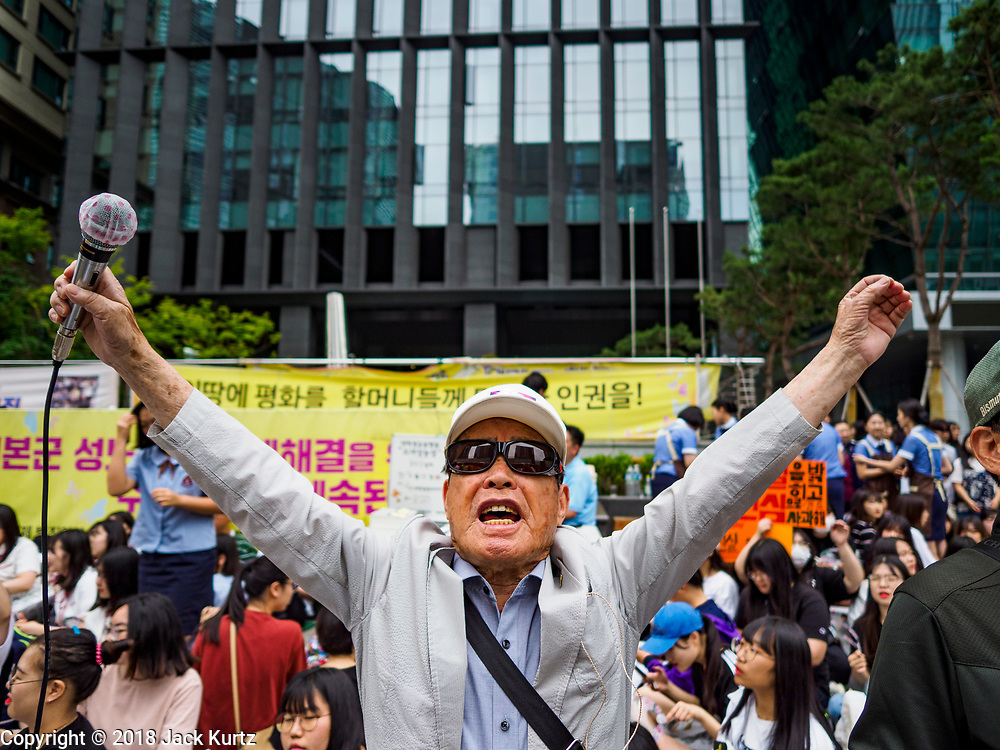 """SEOUL, SOUTH KOREA: A South Korean man leads chants against the Japanese embassy in Seoul during the Wednesday protest. The Wednesday protests have been taking place since January 1992. Protesters want the Japanese government to apologize for the forced sexual enslavement of up to 400,000 Asian women during World War II. The women, euphemistically called """"Comfort Women"""" were drawn from territories Japan conquered during the war and many came from Korea, which was a Japanese colony in the years before and during the war. The """"comfort women"""" issue is still a source of anger of many people in northeast Asian areas like South Korea, Manchuria and some parts of China.        PHOTO BY JACK KURTZ   <br /> Wednesday Demonstration demanding Japan to redress the Comfort Women problems"""
