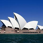 Sydney's Opera House on Bennelong Point with a clear blue sky on a sunny day