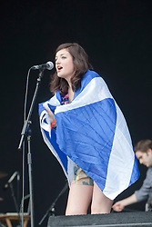 Katie Sutherland of Pearl and the Puppets on the main stage wearing a Scottish Saltire. Sunday 13th June 2010..Pic ©2010 Michael Schofield. All Rights Reserved.