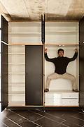 room with wardrobe, man inside