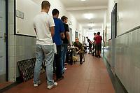01 JUN 2010, BERLIN/GERMANY:<br /> Wehrpflichtige - am ersten Tag nach Ihrer Einberufung zur Bundeswehr - stehen für eine medizinische Untersuchung in eienr Warteschlange, Wachbataillon der Bundeswehr, Jukius-Leber-Kaserne<br /> IMAGE: 20100701-01-001<br /> KEYWORDS: Wehrpflicht, Soldaten, Soldat, Bundeswehr