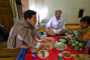 Traditional knife seller Bashir Sabana enjoys a noon day meal with family members at his home in Sanaa, Yemen. (Bashir Sabana is one of the people interviewed for the book What I Eat: Around the World in 80 Diets.)