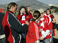 Fotball / Football<br /> Tyskland - Germany<br /> FC Köln training at La Manga - Spain<br /> 05-14.01.2007<br /> Foto: Morten Olsen, Digitalsport<br /> <br /> GERMANY OUT<br /> <br /> Christoph Daum writing his autograph on a fan shirt