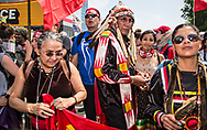 Indigenous elders, Chief Arvil Looking Horse, and Paula Horne-Mullen with others lining up at the front of the Climate March in Washington D.C. Arvil is proud to march on the  sacred land of indigenous people.