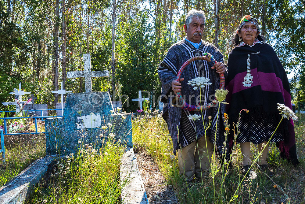 Don Rosendo Curilaf, 90 and wife Margarita 89 at the burial site of their ancestors, a Mapuche cemetery in Cuno. Rosendo is a guardian of tradition and culture and knows everything about Mapuche rites and rituals, including burial which he conducts at the request of members of his community, Cuno, Chile. February 12, 2018.