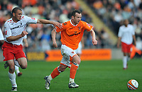 Blackpool's Charlie Adam (on loan from Rangers) and James Perch (Team Captain) of Nottingham Forest<br /> Blackpool vs Nottingham Forest<br /> Coca Cola Championship, Bloomfield Road, Blackpool, UK<br /> 25/04/2009. Credit Colorsport/Dan Rowley