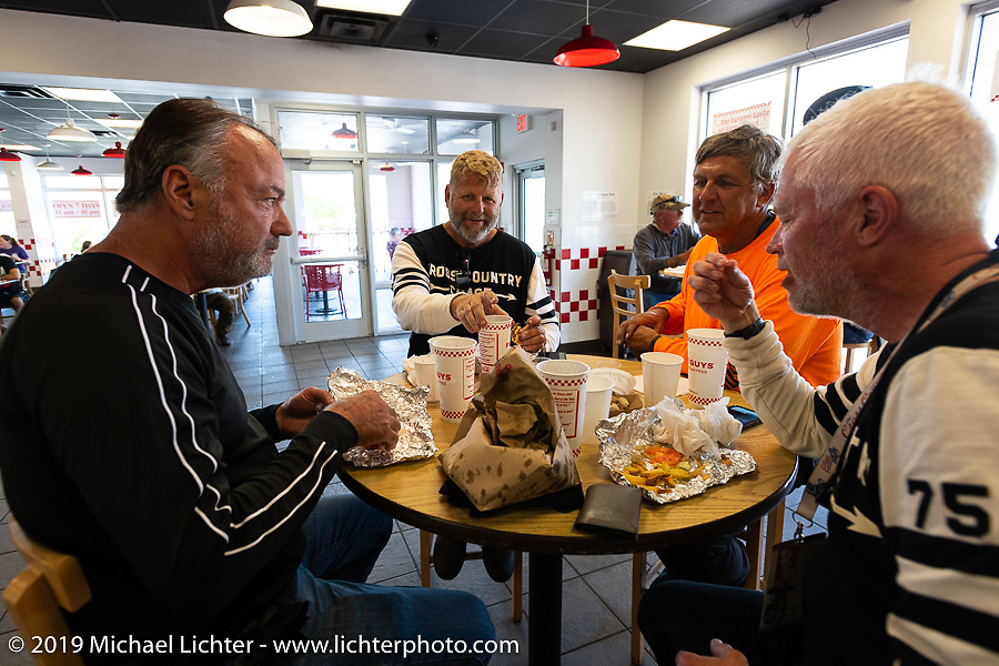 Riding buddies Brian, Marty, Pat and Gary enjoy a 5-Guys burger during the Cross Country Chase motorcycle endurance run from Sault Sainte Marie, MI to Key West, FL. (for vintage bikes from 1930-1948). Stage-10 covered 110 miles from Miami to the finish in Key West, FL USA. Sunday, September 15, 2019. Photography ©2019 Michael Lichter.