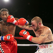Leonardo Kenon (L) and Tommy Bryant exchange punches during a Fire Fist Boxing Promotions boxing match at the A La Carte Pavilion on Saturday, August 12 , 2017 in Tampa, Florida.  (Alex Menendez via AP)