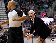 San Antonio Spurs coach Gregg Popovich, right, yells at official Leon Wood for a timeout during the first half of an NBA basketball game against the Utah Jazz in Salt Lake City, Friday, Nov. 19, 2010. (AP Photo/Colin E Braley)