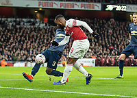 Football - 2018 / 2019 FA Cup - Fourth Round: Arsenal vs. Manchester United <br /> <br /> Alexandre Lacazette (Arsenal FC) chips over the outstretched leg of Eric Bailly (Manchester United) at The Emirates Stadium.<br /> <br /> COLORSPORT/DANIEL BEARHAM