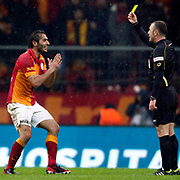 Referee's Tolga Ozkalfa show the yellow card to Galatasaray's Hamit Altintop (L) during their Turkish superleague soccer derby match Galatasaray between Besiktas at the TT Arena at Seyrantepe in Istanbul Turkey on Sunday, 27 January 2013. Photo by Aykut AKICI/TURKPIX