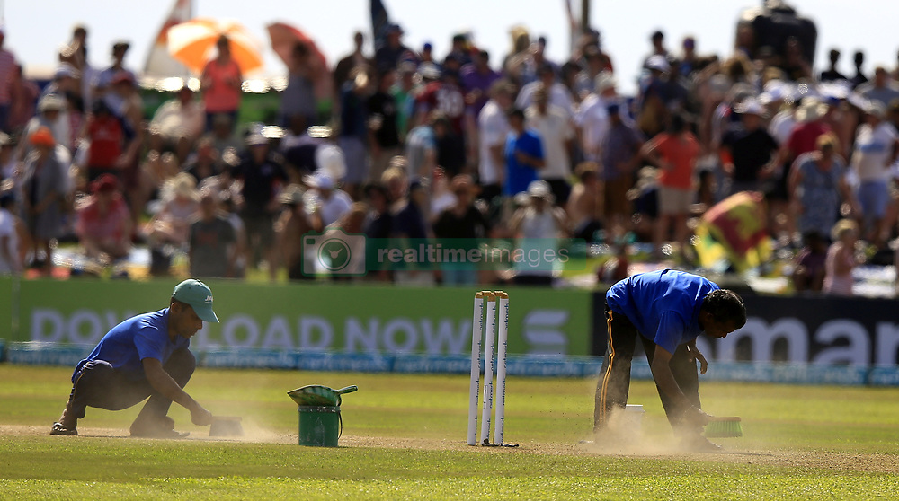 November 7, 2018 - Galle, Sri Lanka - The dust on the pitch is cleaned by workers at an innings break during the 2nd day's play of the first test cricket match between Sri Lanka and England at Galle International cricket stadium, Galle, Sri Lanka. 11-07-2018  (Credit Image: © Tharaka Basnayaka/NurPhoto via ZUMA Press)