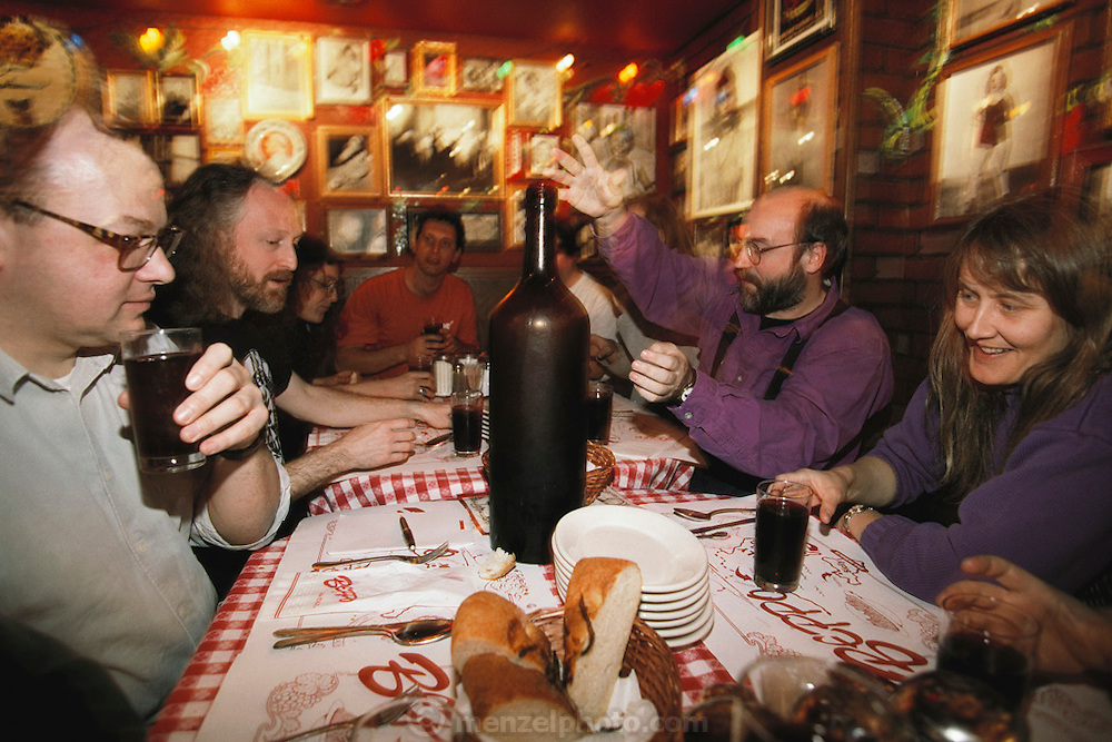 """Silicon Valley, California; At a Palo Alto restaurant, Mark Weiser, head of Xerox Parc research center in purple having dinner with his band called """"Severe Tire Damage"""" before practicing. (1999)."""